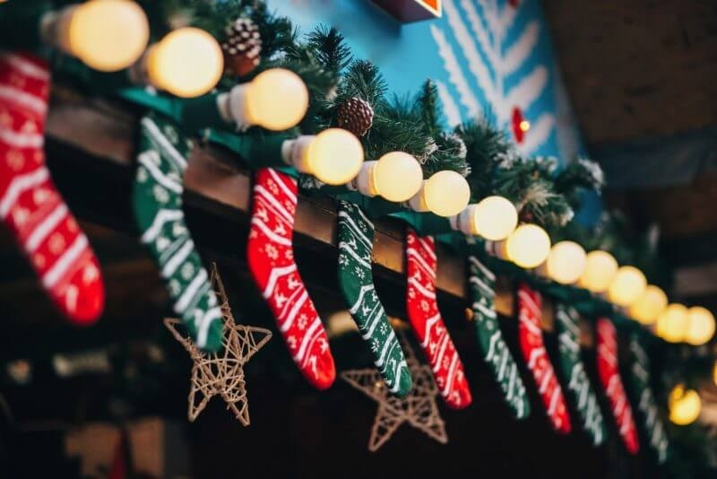 Cabins with stylish christmas decorations on european city market